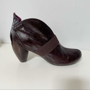 Jump leather ankle booties in a brownish purple color